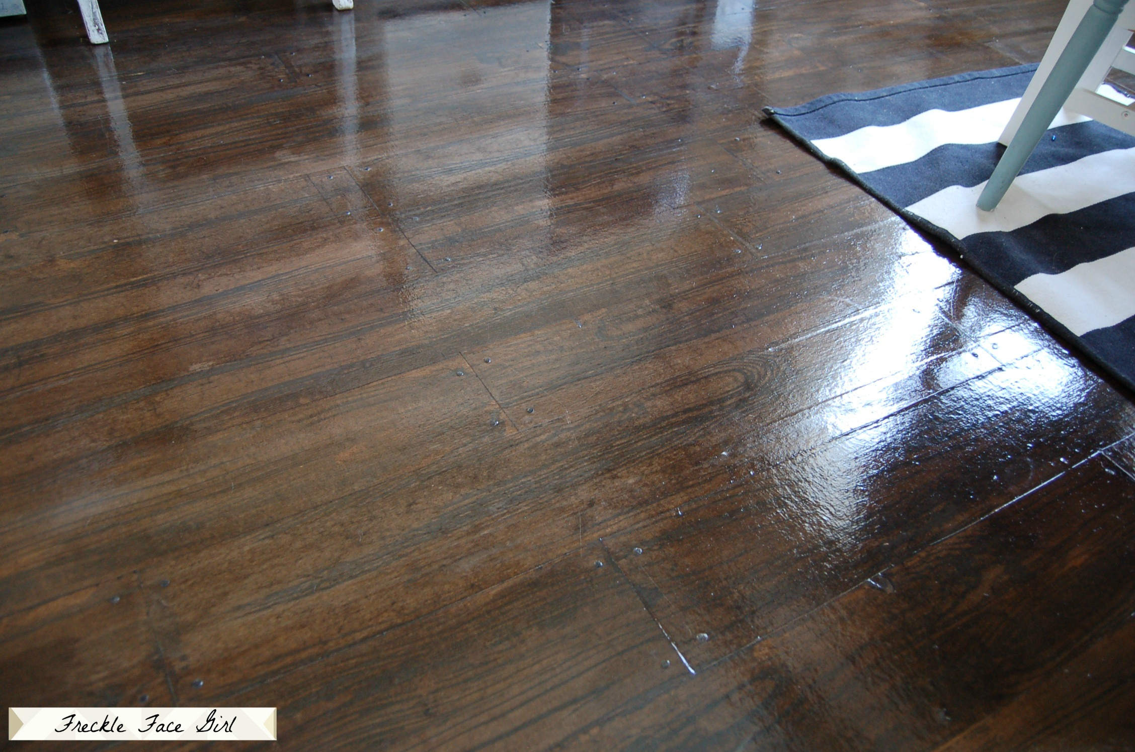 Faux wood plank floors using brown paper remodelaholic for Artificial hardwood flooring