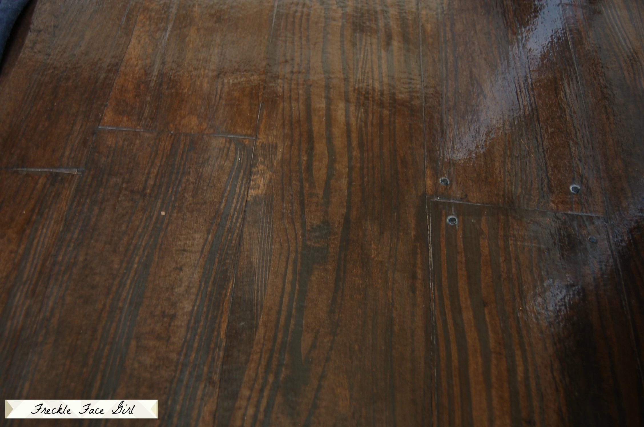 Remodelaholic faux wood plank floors using brown paper for Faux wood flooring