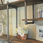 feature use PVC pipe to build an inexpensive industrial-style shelf, Sawdust 2 Stitches on Remodelaholic