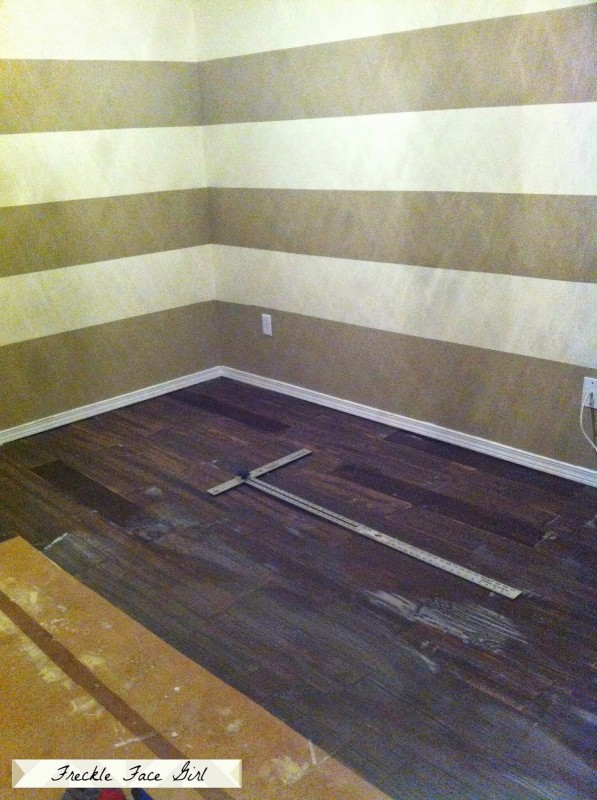 gluing down faux wood plank floor, Freckle Face Girl for Remodelaholic