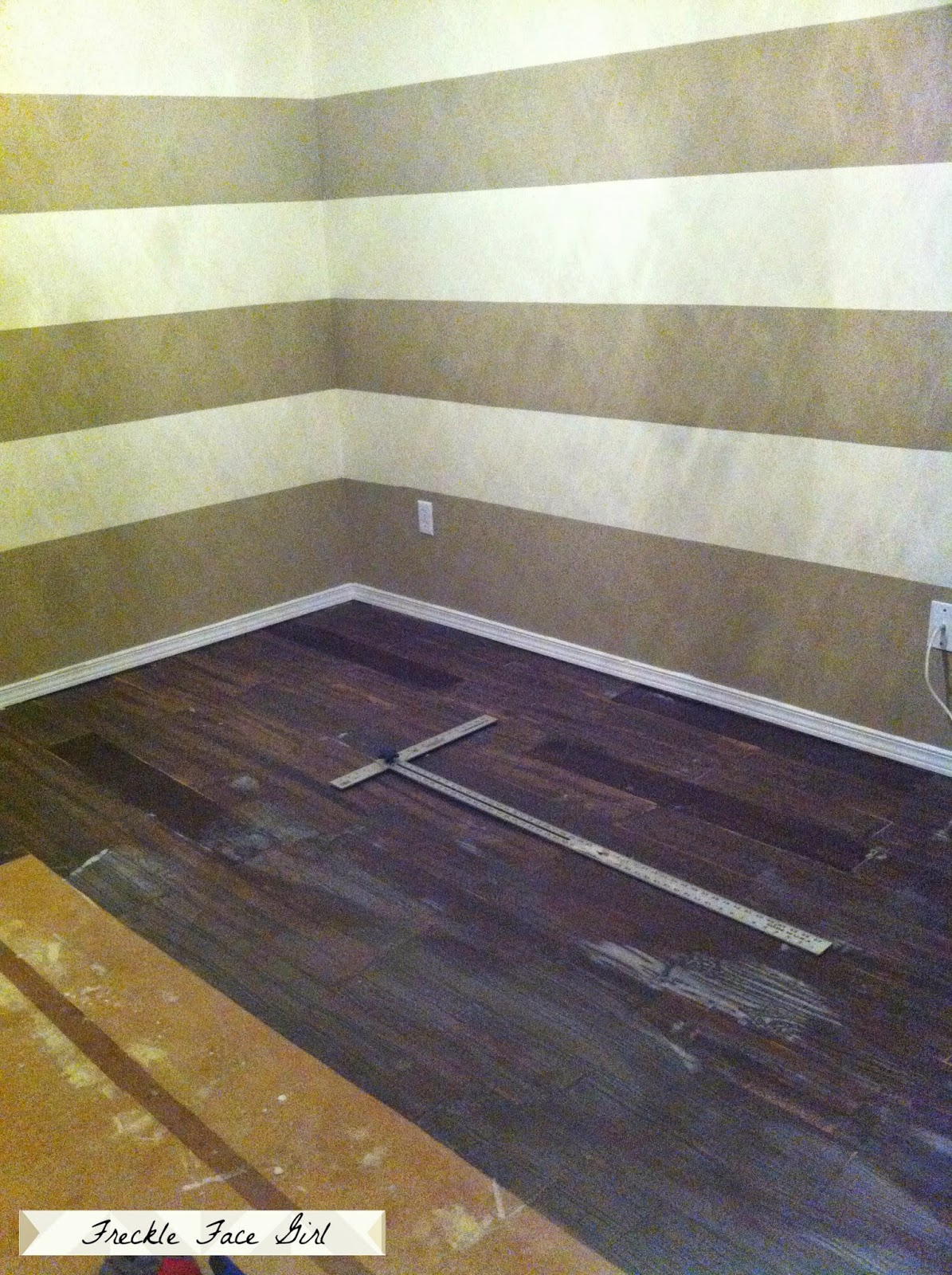 Faux wood plank floors using brown paper remodelaholic for Faux wood flooring