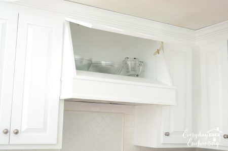 hinged range hood with hidden storage, Everyday Enchanting on Remodelaholic