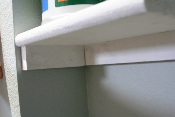 how to install a corner laundry room shelf, Love Melinda on Remodelaholic