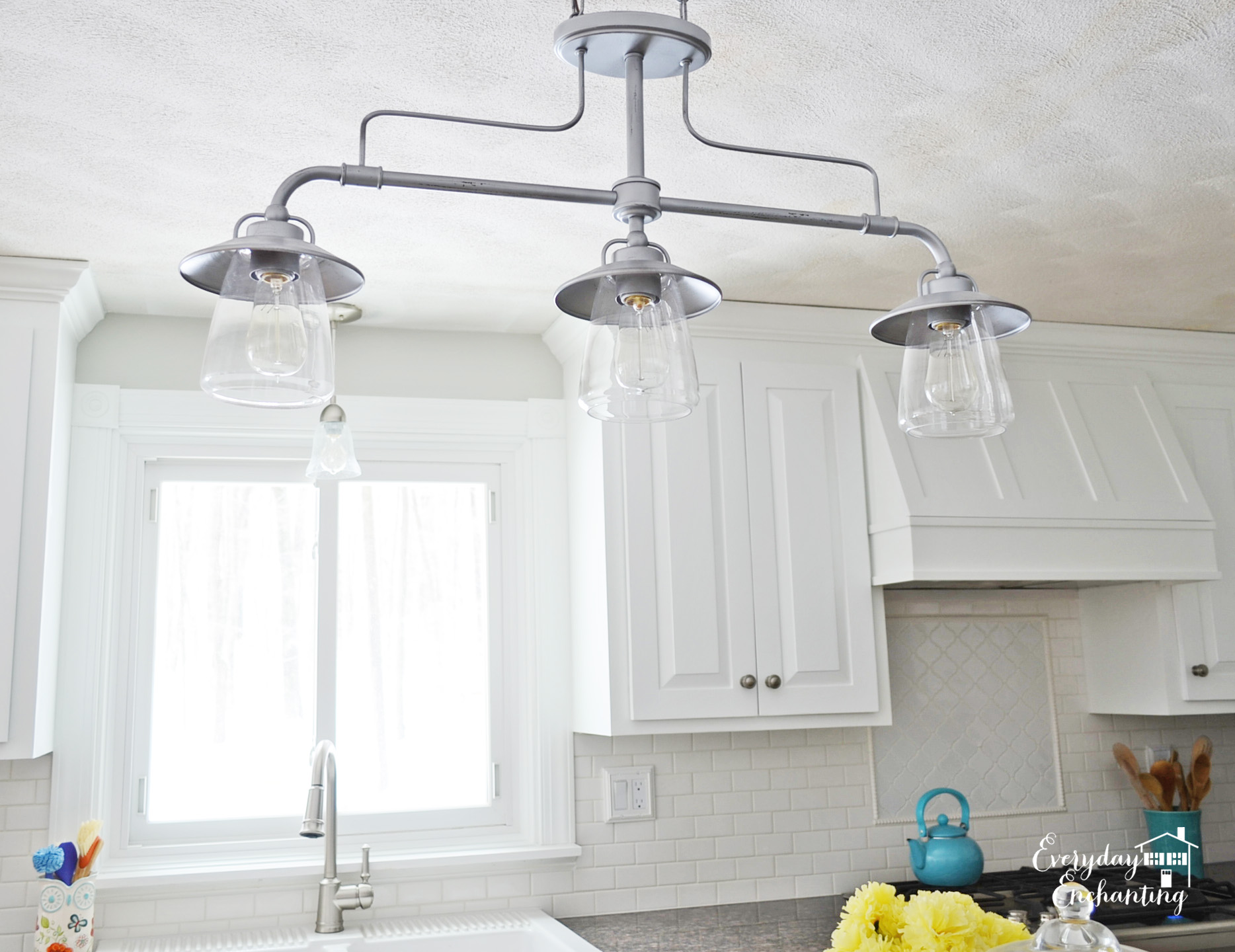 Remodelaholic white kitchen overhaul with diy marble island for Island kitchen lighting fixtures