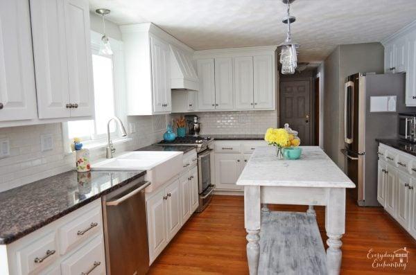 marble kitchen island in white kitchen, Everyday Enchanting on Remodelaholic