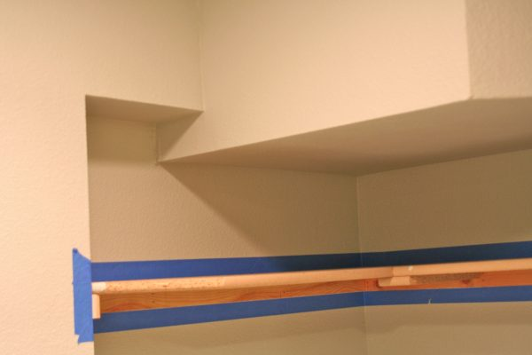 painting laundry room shelves, Love Melinda on Remodelaholic