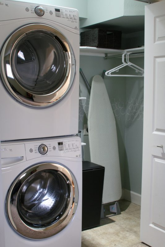 small laundry room with stacked washer and dryer, Love Melinda on Remodelaholic