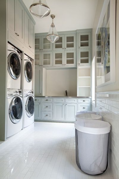 Double laundry large space laundry room with a white and bright theme featured on Remodelaholic.com