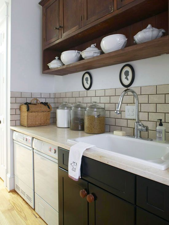 Formal pretty storage in Laundry room featured on Remodelaholic.com