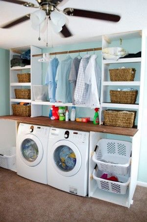 Great sorting space in a laundry area featured on Remodelaholic.com