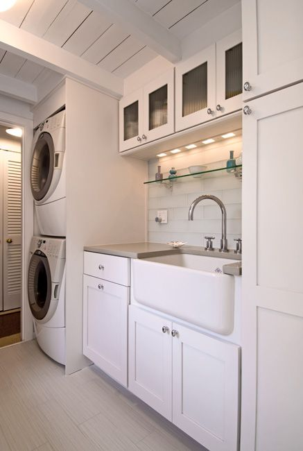 Stacked laundry with sink for hand washing and lots of storage featured on Remodelaholic.com