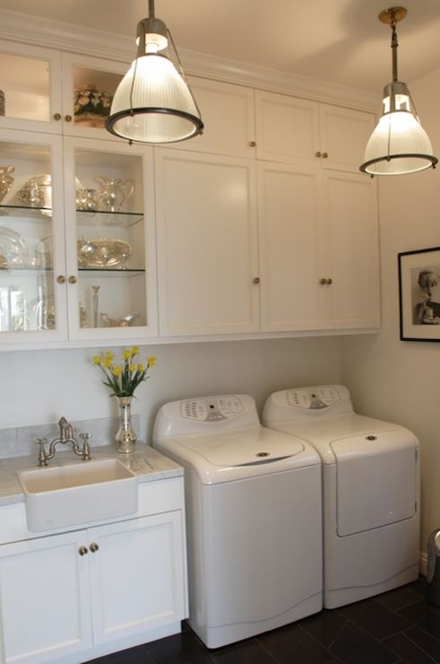 Tall ceilings laundry room with fancy touches featured on Remodelaholic.com