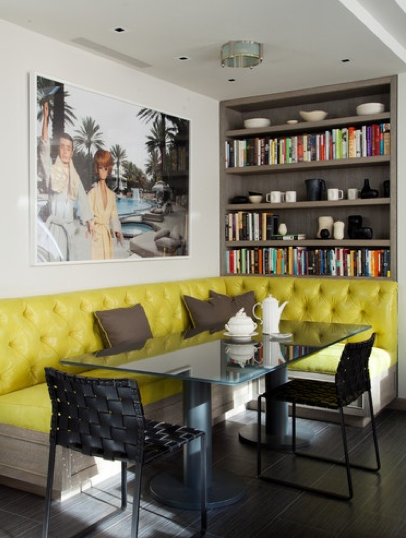 green and gray corner banquette with bookshelf