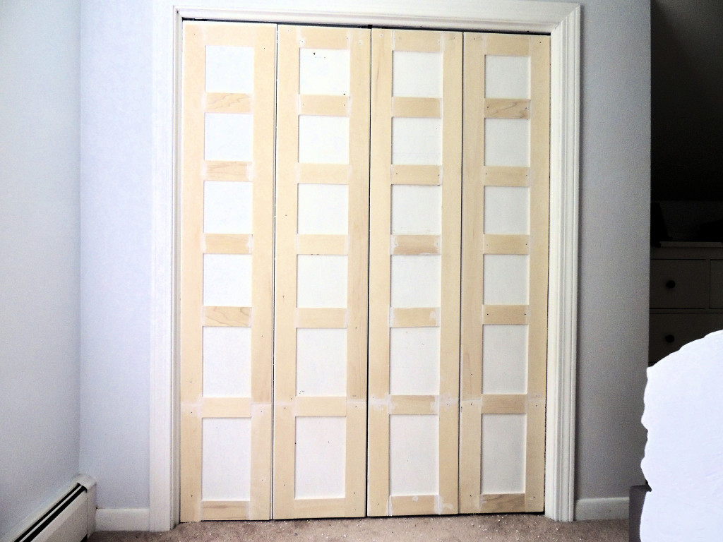 Remodelaholic bi fold to paneled french door closet makeover how to update flat closet doors to paneled french doors 3 wife in progress on vtopaller Image collections