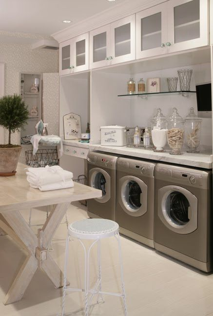 large Laundry room with great storage and multiple machines featured on Remodelaholic.com