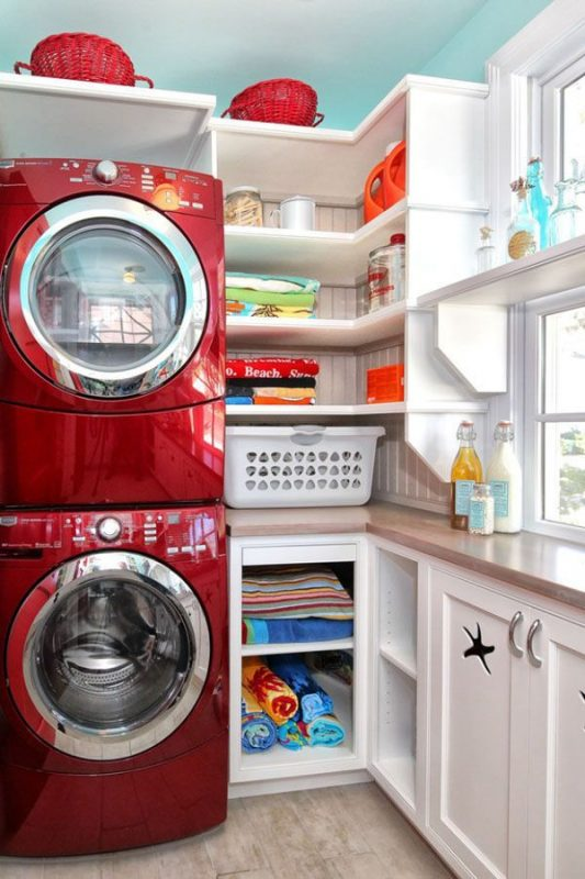 making due with a small space stacked machines and built ins featured on remodelaholic.com