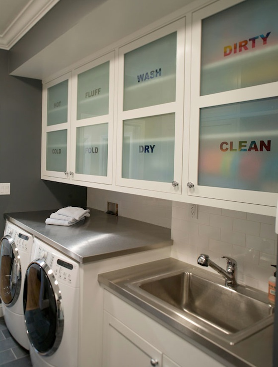 modern cabinet frosted glass storage area above washer and dryer in the laundry room featured on Remodelaholic.com