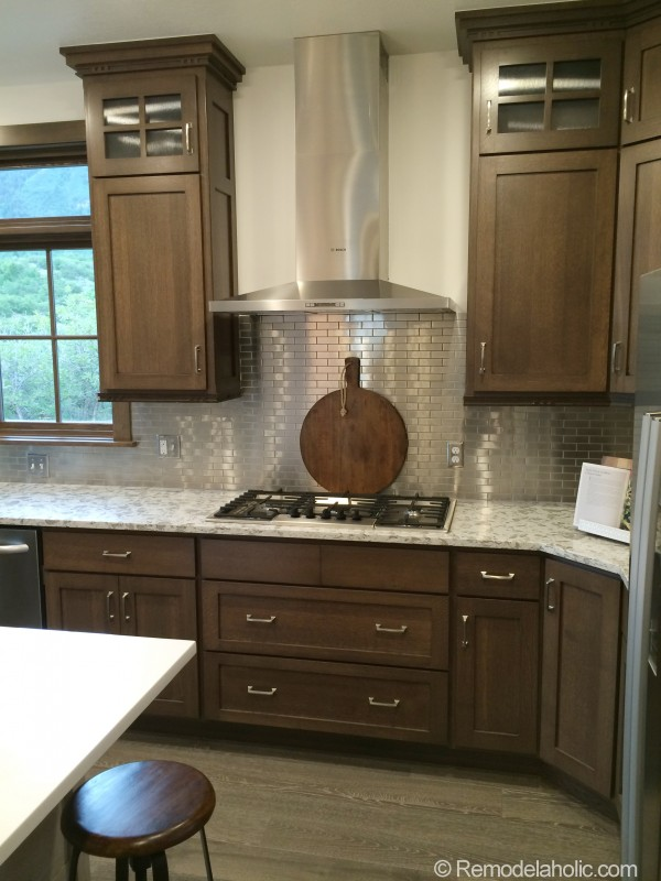 Walnut kitchen with Stainless steel tile backsplash