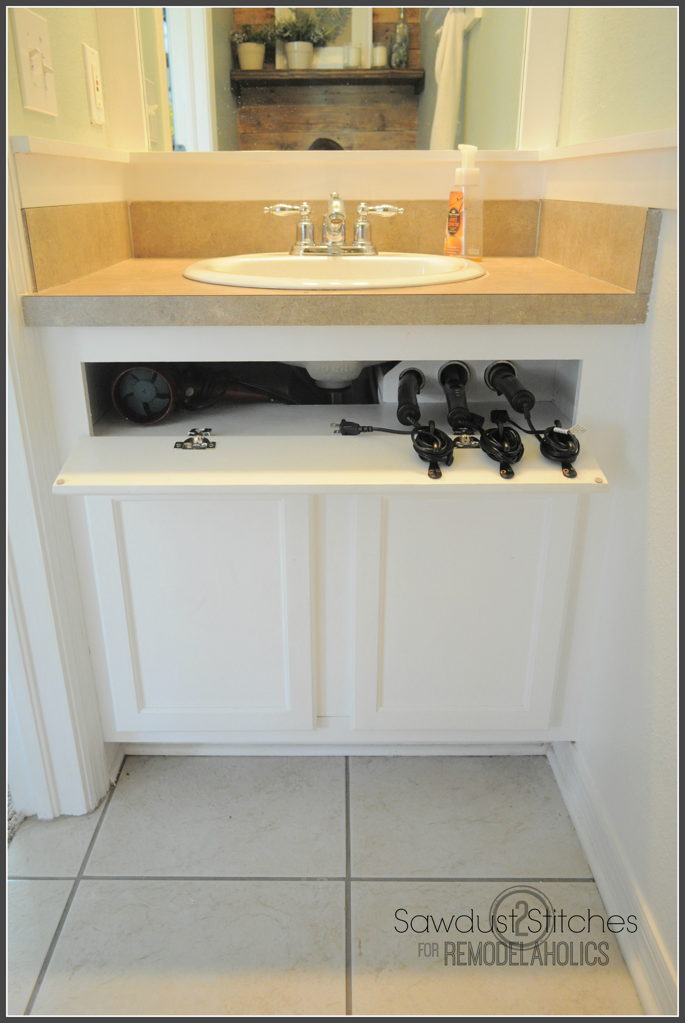 Remodelaholic diy under the sink hair tool storage for Diy bathroom sink cabinet