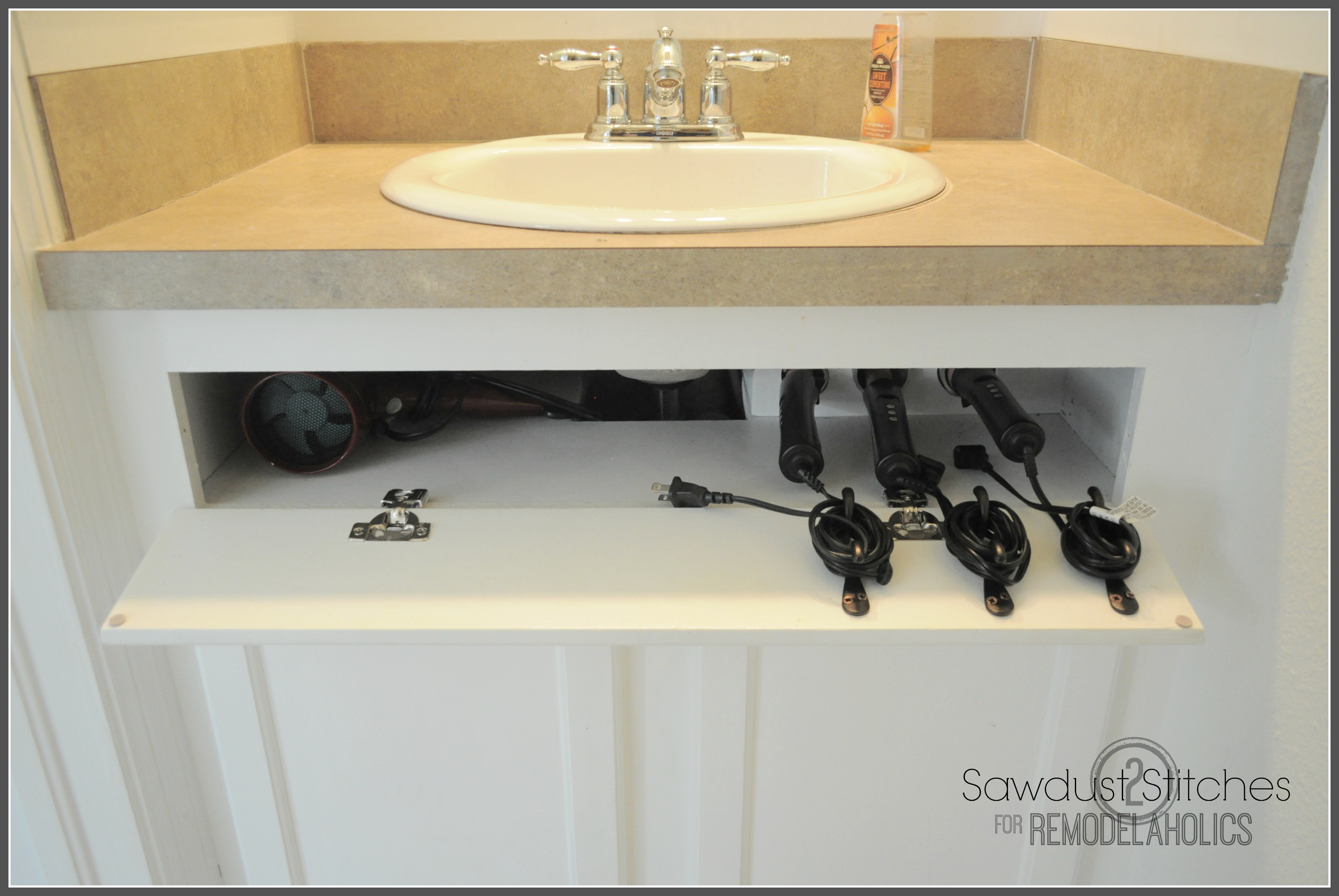 Remodelaholic | DIY Under-the-Sink Hair Tool Storage
