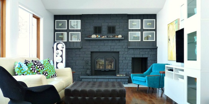 A traditional-style faux stone fireplace becomes a gorgeous focal wall by painting it gray! See the before and after of the painted fireplace