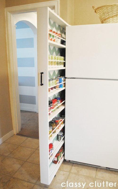hidden pantry storage by fridge