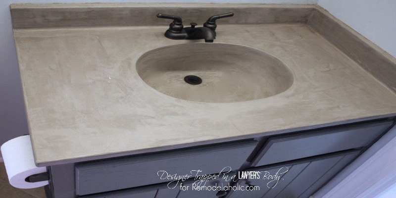 Learn how to transform a cultured marble counter top and sink with concrete. Remodelaholic   DIY Concrete Vanity  with integral sink