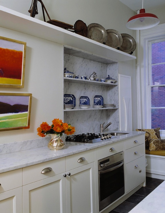 galley kitchen layout with marble countertops via DecorPad