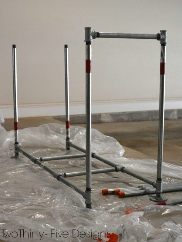 how to build a pipe frame for a mudroom locker system 06, Two Thirty Five Designs on Remodelaholic