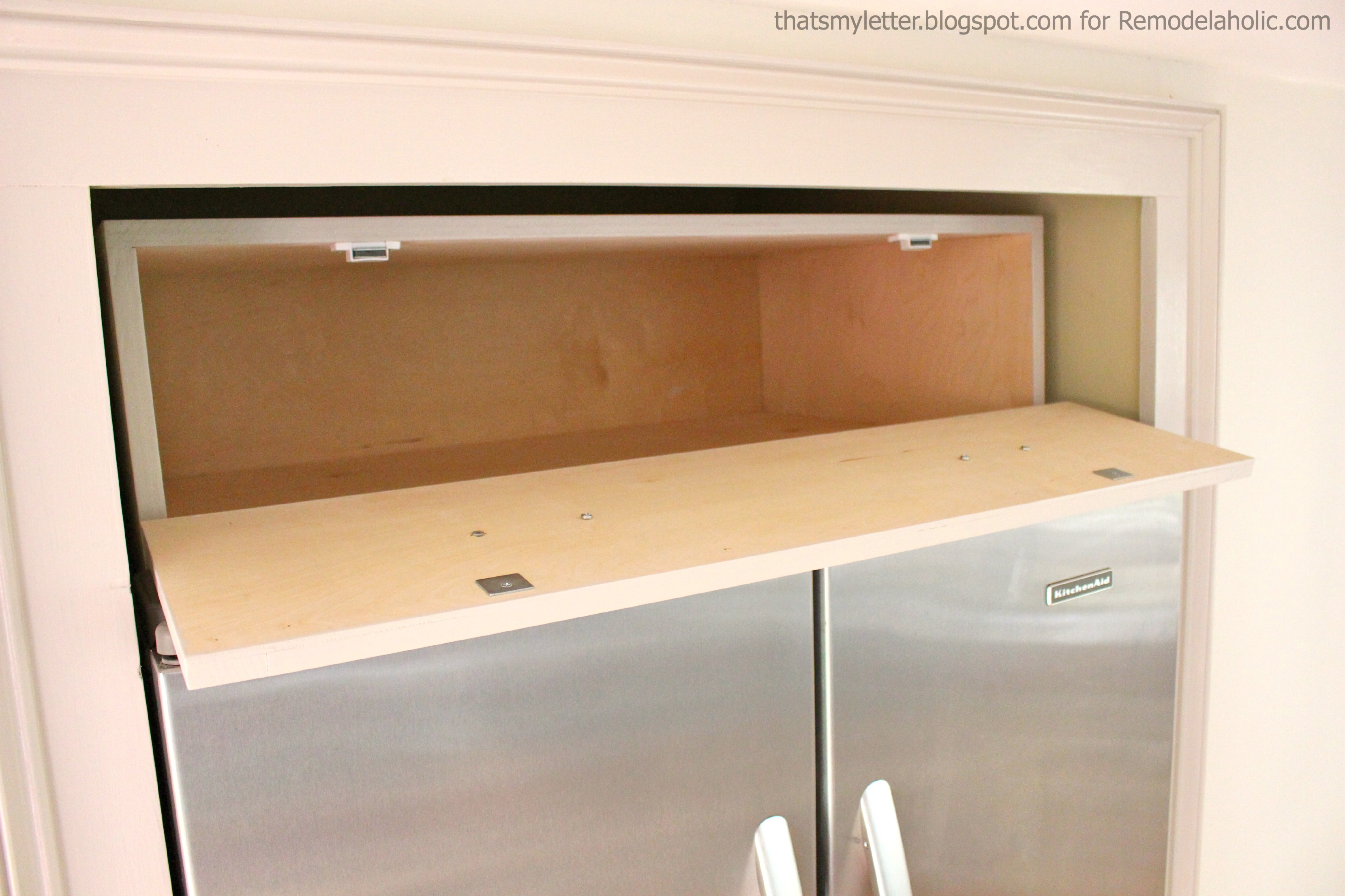 remodelaholic | build a cabinet over the fridge