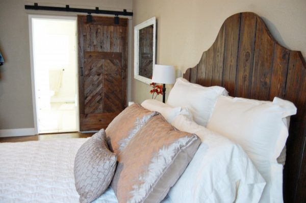 rustic wood bed and barn door, The Accent Piece on Remodelaholic