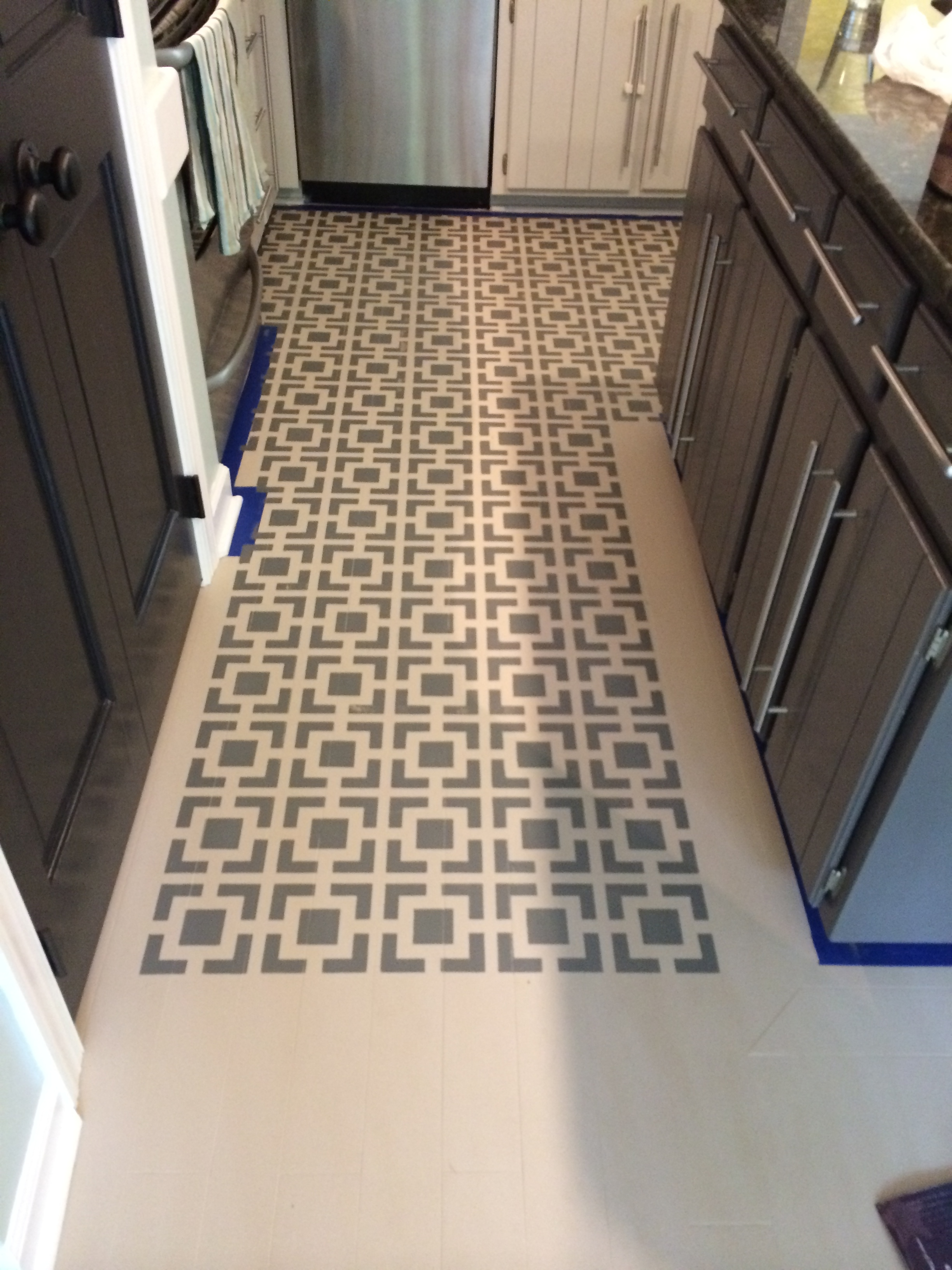Diy stenciled floors a full tutorial designer trapped paint and stencil your kitchen floors for high impact on a tiny budget dailygadgetfo Images