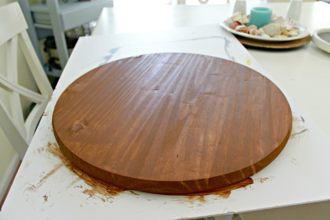 first start by painting or staining your piece of pine i chose to stain mine since my table is already white i used preloaded stain cloths which