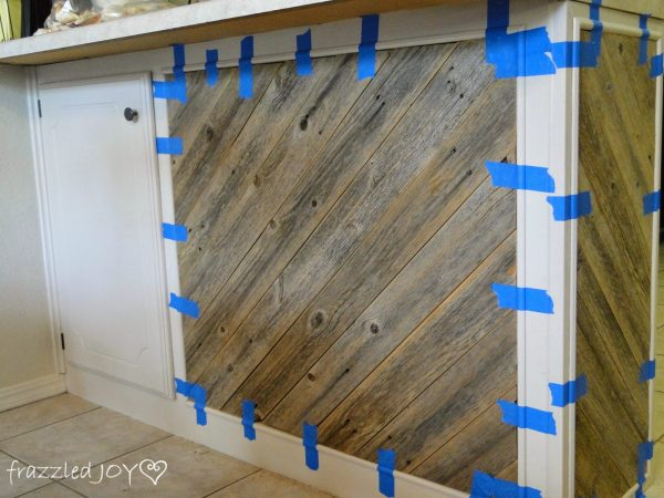 adding trim to reclaimed wood plank kitchen island, Frazzled Joy on Remodelaholic