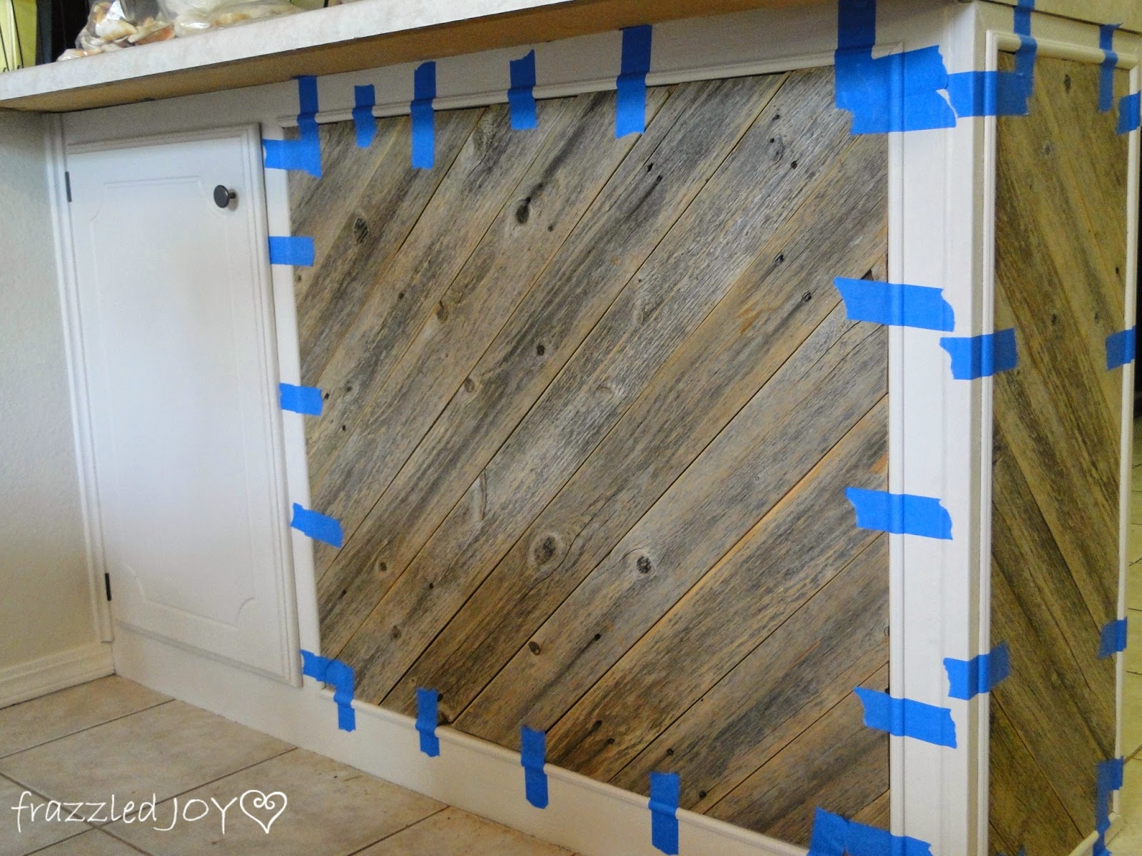 Best adding trim to reclaimed wood plank kitchen island Frazzled Joy on Remodelaholic