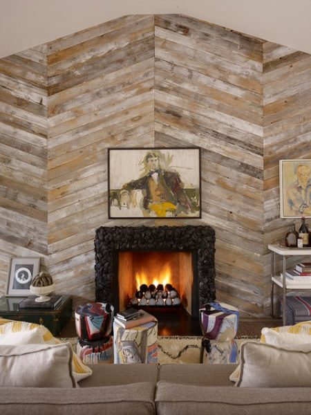 large wood plank accent wall with fireplace