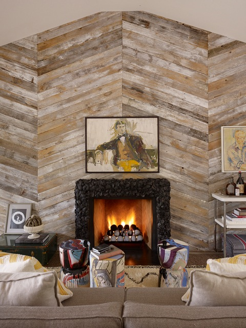 Spectacular large wood plank accent wall with fireplace