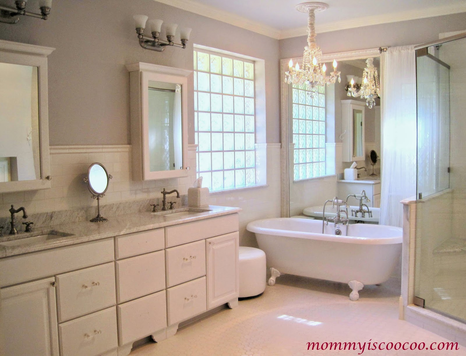 Epic white bathroom makeover with builder grade mirror framed behind tub Mommy is Coocoo on Remodelaholic
