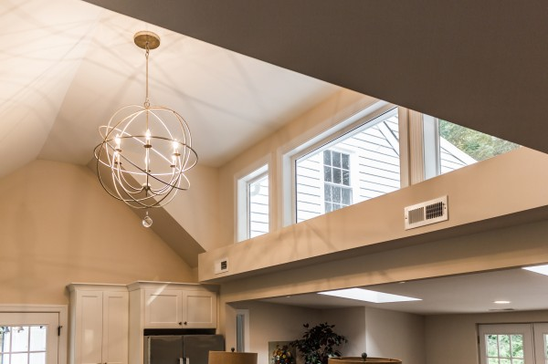 5 orb chandelier in open kitchen and dining with high ceilings, Cobblestone DG on Remodelaholic