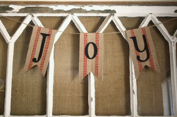 A Diamond in the Stuff -- old window with burlap for mantel - via Remodelaholic