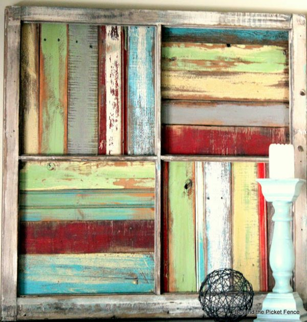 Beyond The Picket Fence - salvaged window into wood scrap wall art - via Remodelaholic
