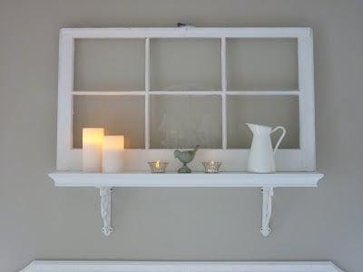 Cottage Living - old window shelf above bed - via Remodelaholic