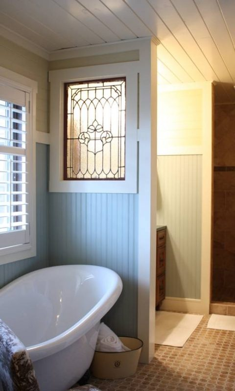 Decorate with a Little Bit - old window in bathroom wall - via Remodelaholic
