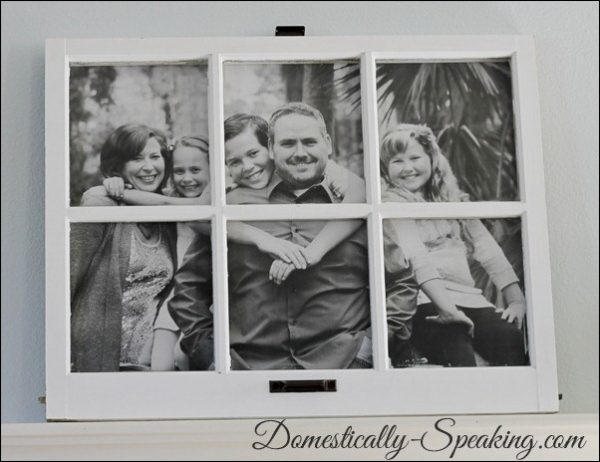 Domestically Speaking - family photo framed in paned window - via Remodelaholic