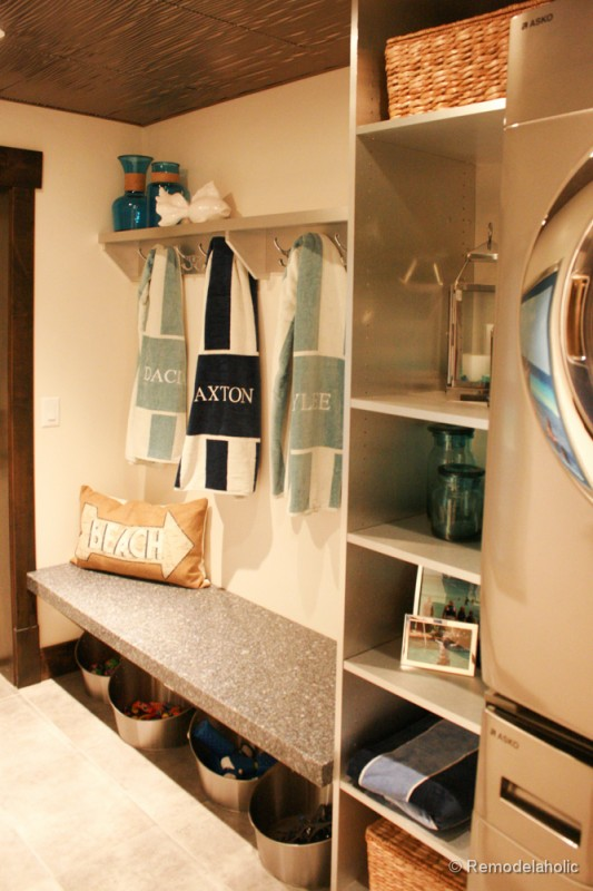 Mudroom laundry room combo right off the pool. Fabulous Laundry room design ideas from @Remodelaholic