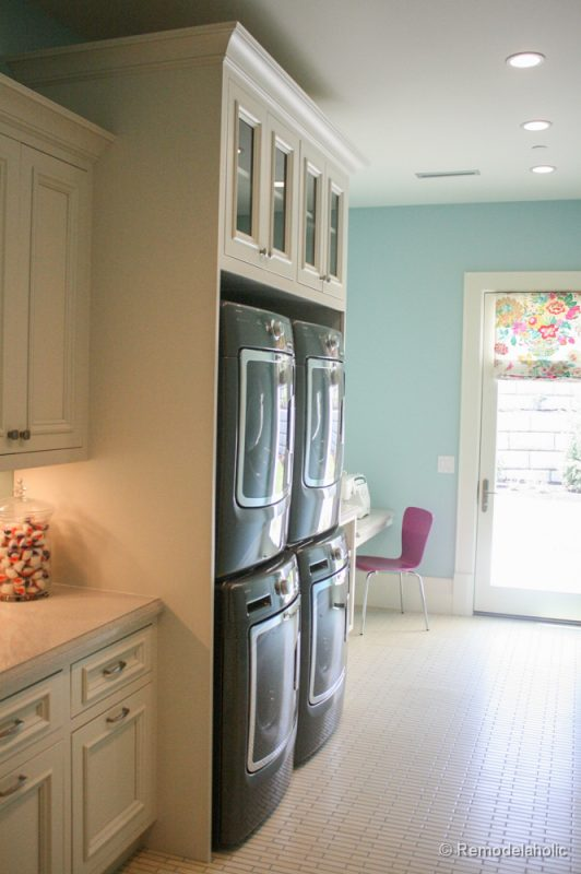 Double stacked machines for efficient laundry completion. Fabulous Laundry room design ideas from @Remodelaholic