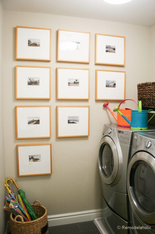 Pretty gallery wall in a laundry room! Fabulous Laundry room design ideas from @Remodelaholic