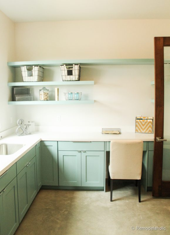 Fabulous Laundry room design ideas from @Remodelaholic Mint colored cabinets in a large multi-purposed laundry room