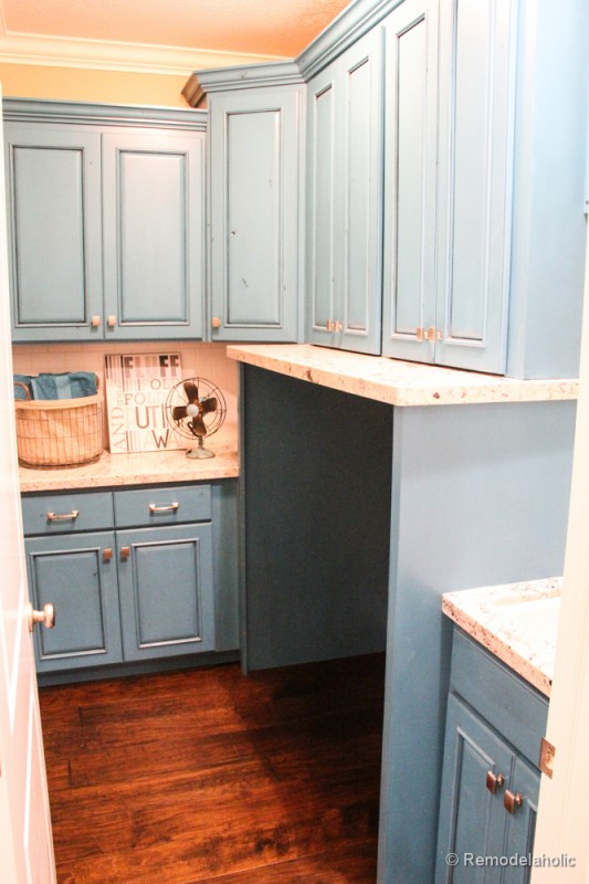 Fabulous Laundry room design ideas from @RemodelaholicPretty blue cabinets with a built in area for the machines.