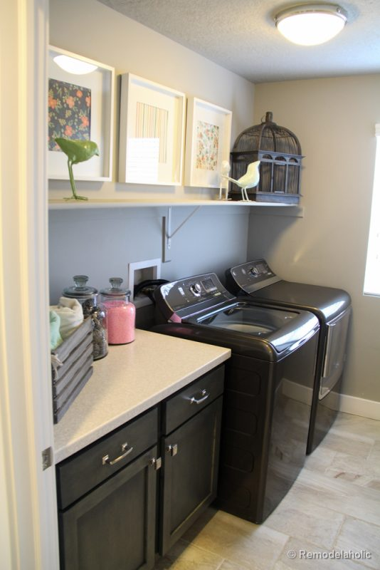 A shelf for storage or decor and a tabletop for folding in a small laundry room. Fabulous Laundry room design ideas from @Remodelaholic